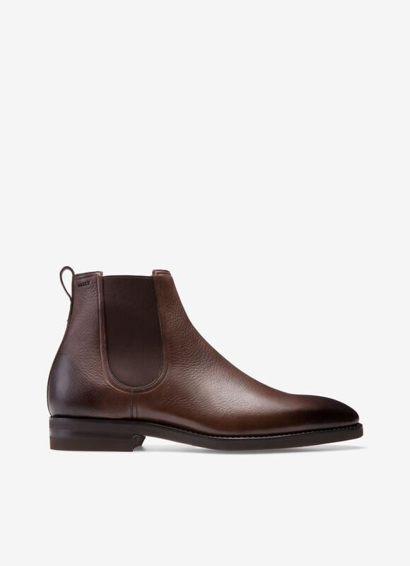 The most innovative Bally Scribe offering, this exquisite handmade Chelsea boot is the contemporary incarnation of artisanal craftsmanship. Finest deer leather is dyed brown and polished by hand, and mounted onto the most lightweight rubber sole ever to be found on a Goodyear construction, developed exclusively for Bally. This versatile yet high-quality amalgamation of materials results in a water-resistant and functional design that is ideal for the gentleman traveler and the city dweller.