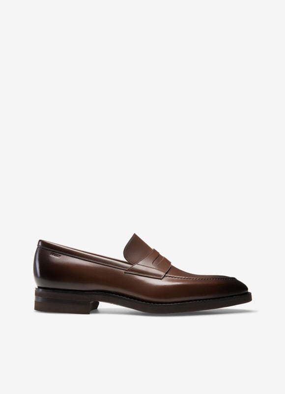 This exquisite handmade brown loafer is the contemporary incarnation of artisanal craftsmanship, and the most innovative offering of Bally Scribe. Finest German calf leather is dyed and polished by hand, and mounted onto the most lightweight rubber sole ever to be found on a Goodyear construction, developed exclusively for Bally. This versatile yet high-quality amalgamation of materials results in a water-resistant and functional design that is ideal the gentleman traveler and the city dweller.