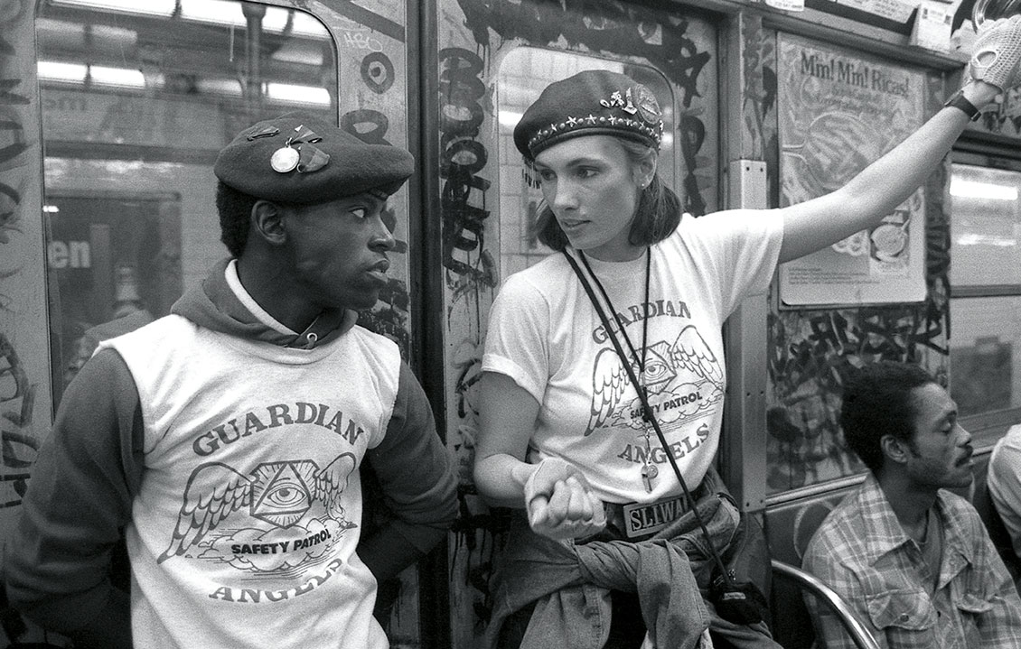 Lisa Sliwa, right,  then-wife of the group's founder Curtis Sliwa, patrols the Subway